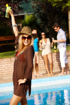 Happy young woman on summer holiday smiling, having fun. photo