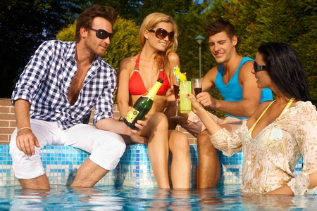 poolside: Young companionship on summer holiday.