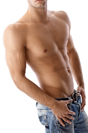 Athletic sexy muscular male body, semi-nude in jeans, bare chest. photo