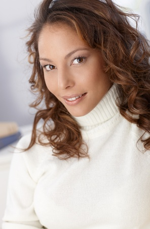 turtleneck: Portrait of beautiful young smiling woman.