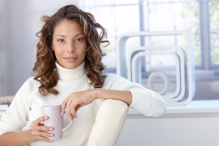 Portrait of young attractive afro woman drinking tea at home. Stock Photo - 13061165