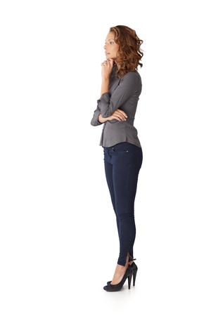 Young female thinking arms crossed, side view. Stock Photo - 13061126