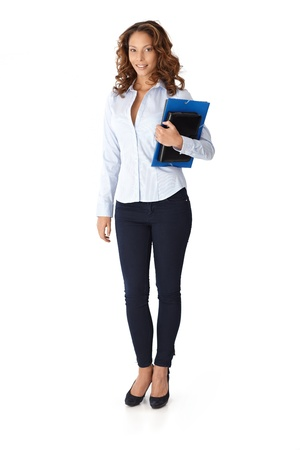 Pretty casual woman holding folders, smiling. Full size. photo
