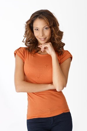 Portrait of attractive casual woman in orange top smiling. Stock Photo - 13061226