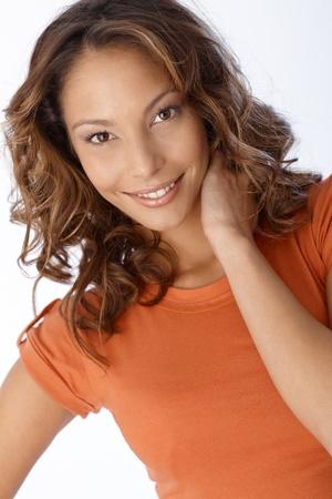 Closeup portrait of beautiful smiling young woman. photo