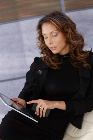 Elegant young woman using tablet computer. photo