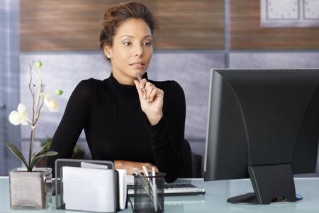 one female: Portrait of attractive working businesswoman in modern office.