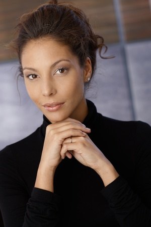 Portrait of young ethnic female in black. photo