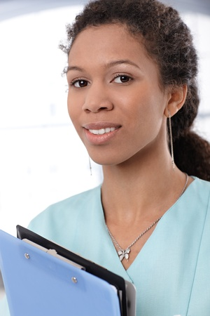 Closeup portrait of cheerful ethnic medical worker. photo