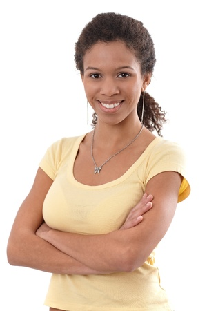 Portrait of pretty ethnic female smiling arms crossed. Stock Photo - 13068691