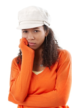 Portrait of disappointed young afro woman in cap and orange pullover. Stock Photo - 13070888