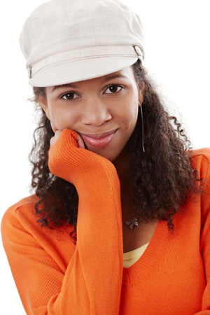 Close-up portrait of afro-american beautiful girl smiling in cap. Stock Photo - 13070959