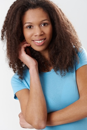 Portrait of attractive afro-american woman smiling with hand in hair. Stock Photo - 13071420