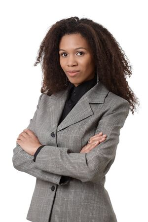 Confident afro-american businesswoman standing arms crossed. photo