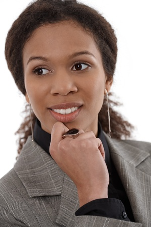 Closeup portrait of young afro-american businesswoman with hand on chin, smiling. photo