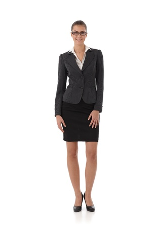 Pretty businesswoman smiling, full size portrait, cutout on white. photo