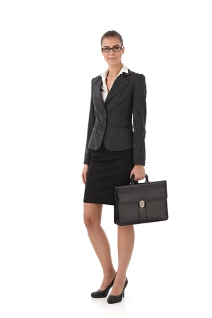 Smiling businesswoman with briefcase handheld, isolated on white. photo