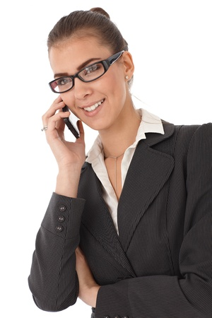Attractive businesswoman smiling, talking on mobile phone, isolated on white. Stock Photo - 13098625