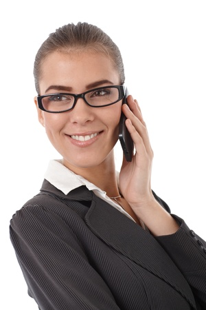 Happy businesswoman smiling, concentrating on mobile phone call. Stock Photo - 13098531