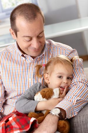 girl bonding: Smiling father hugging little daughter. Stock Photo