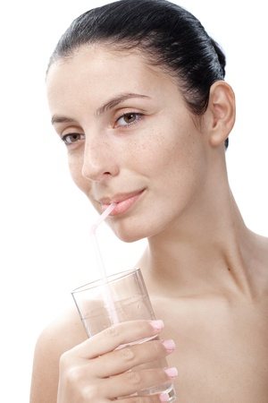 Young natural woman drinking water by straw. photo