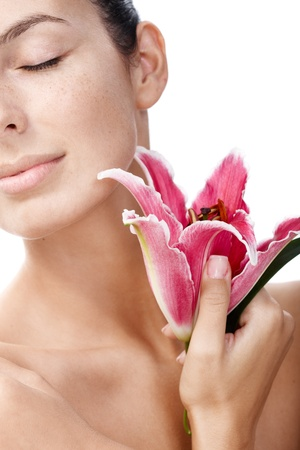 stockphoto: Closeup portrait of pure woman with lily.