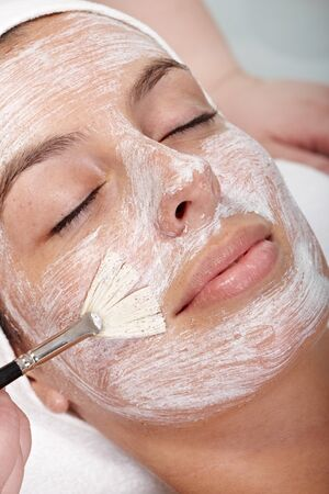 Closeup portrait of young woman with creamy face mask, eyes closed. Stock Photo - 13180363