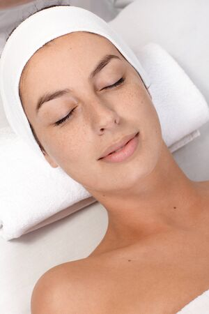 'eyes shut: Young woman laying eyes closed in beauty salon, with clean fresh face.