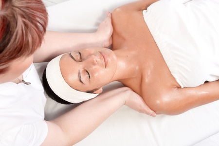 beauty saloon: Young woman receiving massage in beauty saloon, view from above. Stock Photo