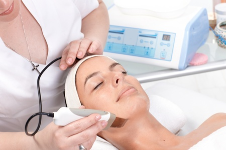 Young woman receiving skin rejuvenating treatment at beauty saloon. Stock Photo - 13180283