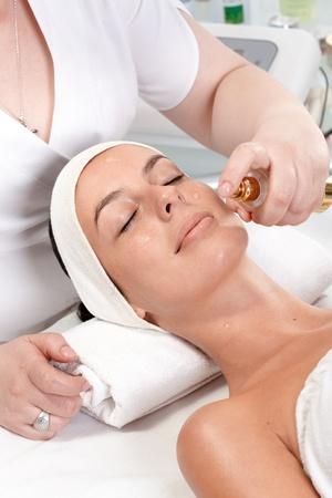 Young woman having facial beauty treatment at beauty salon. Stock Photo - 13180303