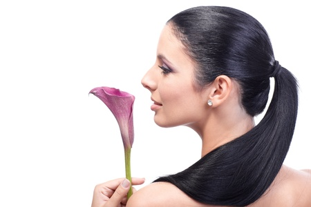 Artistic profile of young attractive woman with calla, long ponytail, view from behind. Stock Photo - 13180289