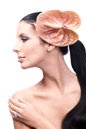 Artistic beauty photo of young model's profile with long ponytail and calla in hair, bare shoulders. Stock Photo - 13180316
