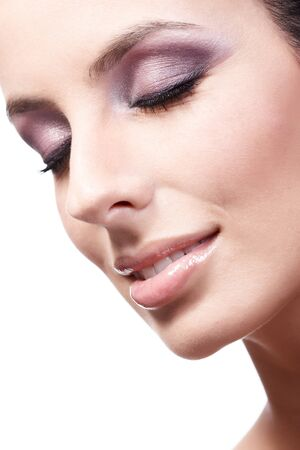 close up image: Closeup beauty portrait of young attractive woman with makeup, eyes closed, smiling. Stock Photo