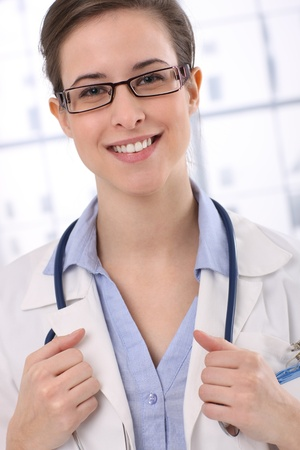 Portrait of smiling young doctor, looking at camera confidently. photo
