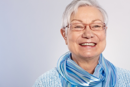 Portrait of happy granny in glasses. photo