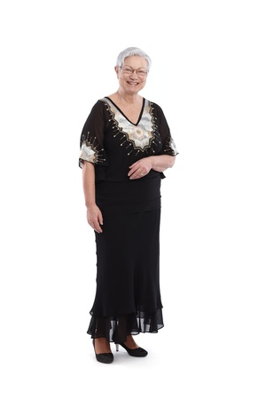 evening gown: Smiling old lady in black and white evening dress   65533; Stock Photo