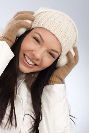 Winter portrait of young attractive smiling woman dressed warm   65533; photo