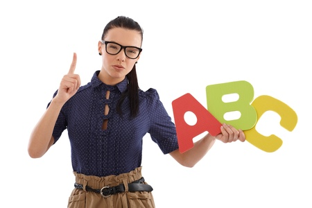 strict: Strict schoolmistress teaching alphabet by holding capital letters in hand. Stock Photo