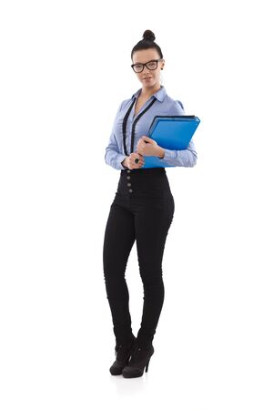 Full size photo of pretty office worker holding folders in hand. photo