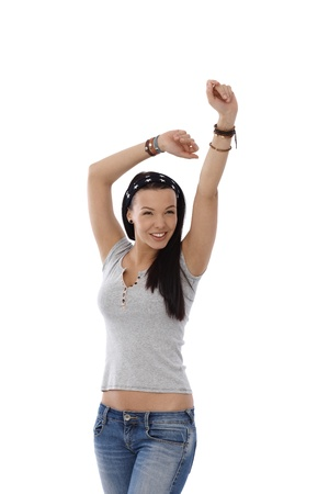 Happy casual girl standing in jeans and t-shirt with hands up. photo