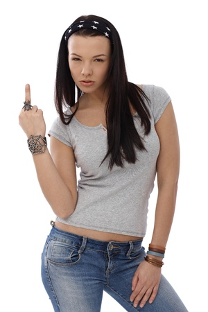 rude: Provocative young girl showing middle finger gesture, wearing spider ring.