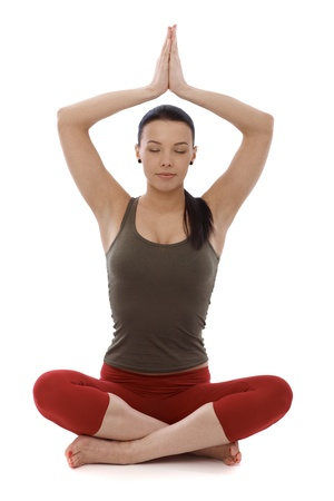 Attractive young woman practicing yoga, relaxing in prayer position eyes closed. photo
