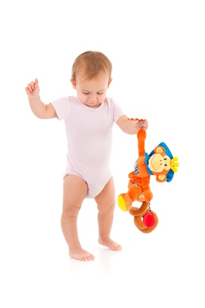 bodysuit: Toddler holding soft toy monkey in hand, standing, balancing