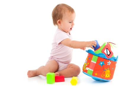 cute baby girl: Cute baby girl lost in playing with toys, wearing bodysuit.