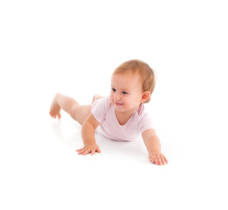 Impish little girl rolling on floor, having fun   65533; photo