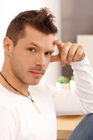 Portrait of young man with trendy hairstyle. photo