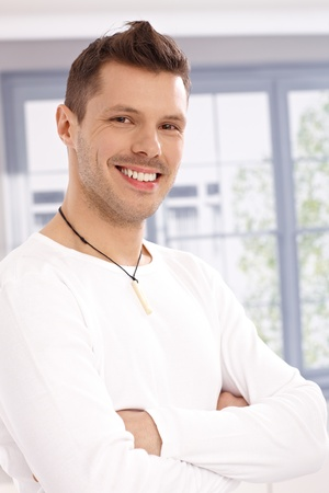 Portrait of confident young man, standing arms crossed, smiling. Stock Photo - 13964704
