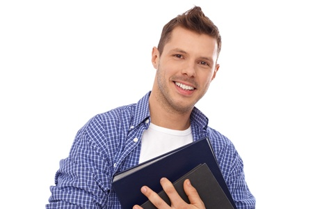 Happy male student holding books, smiling. Stock Photo - 13964705