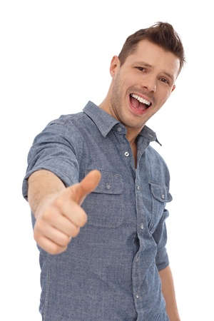 Successful young man showing thumb up, smiling. Yeah. Stock Photo - 13964907